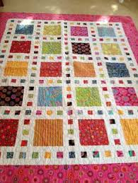 Play a Card quilt designed and quilted by Brigitte Heitland. Let ... & Stunning Modern Handmade Quilt featuring Kaffe Fassett's vibrant bold  colorful fabrics set against a vivid white Adamdwight.com