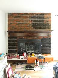black paint was perfect for this old outdated fireplace makeover