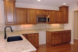wonderful l shaped kitchen with island. Kitchen. Brown Wooden Kitchen Cabinet And Cream Granite Countertops Added By Black Metal Curved Faucet Wonderful L Shaped With Island