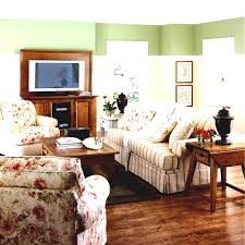 white coastal furniture. Coastal Furniture Ideas For Living Room With White Strip Fabric Sofa And Flower Motif Cushions Funiture