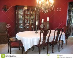 Formal Dining Room With China Cabinet And Chandelier Stock Photo - Dining room table and china cabinet
