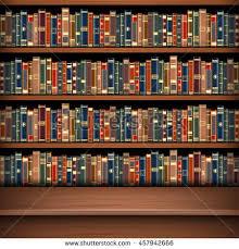 Table on background of bookshelf full of books. Old library