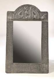 Small Picture Liberty Co pewter wall mirror designed by Archibald Knox circa