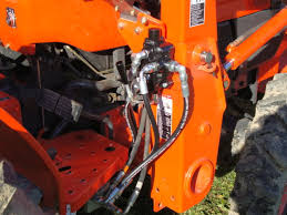 adding rear remote to kubota l i bent the valve lever to reduce the snag hazard on boots and pant legs and plumbed everything as neatly as possible not much room to work
