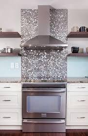 shiny metallic backsplash behind the cooker matches it perfectly