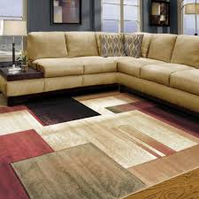 attractive contemporary area rugs combined with creamy sectional sofa and striking night lamp