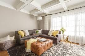 gray leather sectional with yellow pillows