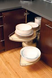 this dura supreme kitchen corner cabinet shelves pivot and pull out for complete access to items