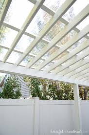 turn your pergola into a covered porch you can now use it all year round