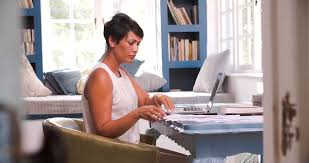 working for home office. Mature Woman At Desk Working In Home Office With Laptop For T