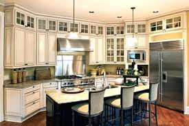 adding small cabinets above existing kitchen cabinets honey oak cabinets adding small