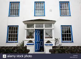 open house door. The Front Door Is Left Partially Open To A House On Island Of Jersey, UK #