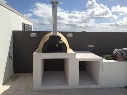 bring the indoors out with a woodfired pizza oven or outdoor kitchen