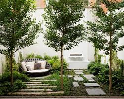 Contemporary New York Garden with Stone Pavers and a Fountain