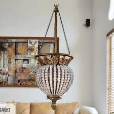 glistening crystal chandelier finished in antique brass with beaded clear strands create timeless elegance