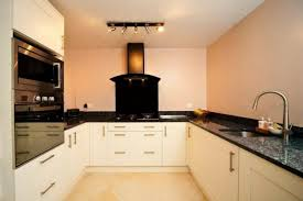 We have chosen a cream wooden shaker style kitchen with black granite  worktops, similar to this, except we don't want the granite spalshback  behind the ...