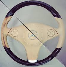 you may also want to remove the steering wheel completely to avoid getting leather colourant on the rest of your interior