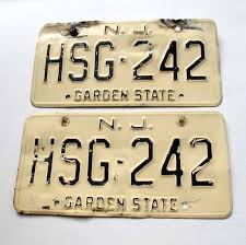 old cream and black plates i still remember the numbers of the license plates on my first car and yes they are called license plates not tags
