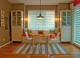 striped rug under dining table