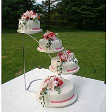Jill A Four Tier Wedding Cake With Hand Made Sugar Roses And Lillies