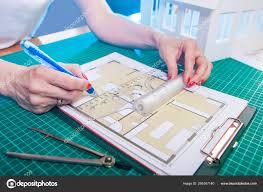 Designer Draftsman The Designer Develops The Floor Plan Of The Building