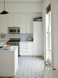 updating white kitchens all white kitchen with patterned mosaic dot bistro style floor design