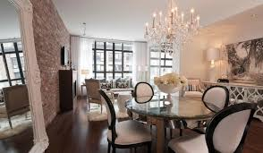 most popular dining room lights with extra large round table and wall brick decor for small spaces