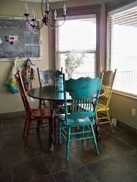 colorful distressed antique dining chairs