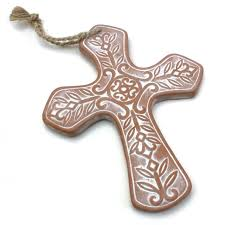 this soft edged and gorgeous terracotta cross is embossed with a fl and leaf pattern that has been whitewashed for a rustic look it can hang on your