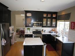black kitchen cabinets white countertops