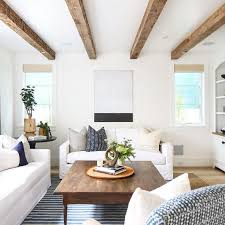 Gorgeous faux beams and soft colors in this airy sun-filled living room.