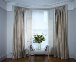 image of large curved window curtain rod