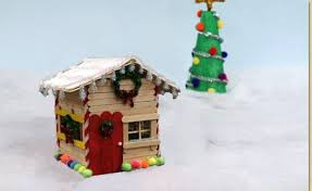 Ideas using gingerbread christmas home decorations Diy Decorate For The Winter Season With An Adorable Wood Stick Gingerbread House Embellished With Shimmer Poms And Shimmer Sticks To Add Snowy Flare Craft Project Ideas Wood Stick Gingerbread House Craft Project Ideas