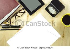 office table top view.  View Office Table Desk Top View With Tablet Pca Cup Of Coffee Pen Pencil  Glasses Clock Book And Blank Paper On Wooden Background And Table Top View