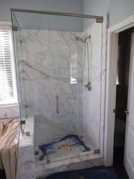 frameless shower door with a brushed nickel shower door header pivot hinges and 3