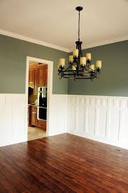 green colored dining rooms. wainscoting in the dining room - classic. but pub rail height with green colored rooms