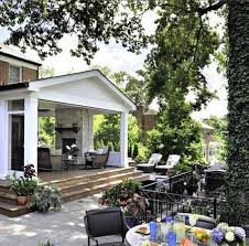 covered patio ideas with outdoor fireplace and loungers