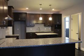 grey granite with espresson cabinets