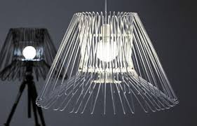 Wire hanger lights from 101 Design Studio (I think I would like a shade on