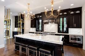 black kitchen cabinets with white marble countertops. Modren Kitchen Gold And Black Kitchen With Thick White Marble Countertops In Cabinets With B