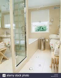 Glass door on shower cabinet in modern bathroom with recessed ...