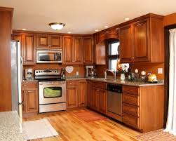 hand made maple glazed kitchen with quartz countertops by gray stain honey oak cabinets