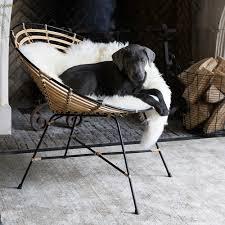 kubu rattan round lounge chair hygge cosy sheepskin throw rattan chair dog puppy