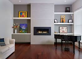 minimalist modern living room with modern glass fireplace and white floating shelves also beige comfy sofa