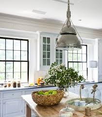 farmhouse kitchen industrial pendant. beautiful farmhouse kitchen with beadboard backsplash white cabinets black honed granite countertops rustic wood island vintage industrial pendant u