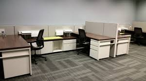 office chairs for small spaces. Beautiful Spaces A Shared Cubicle With Two Black Desk Chairs One Wooden Topped Desk And Intended Office Chairs For Small Spaces