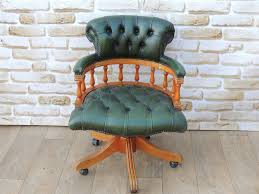 green leather captains chair with light wooden frame delivery