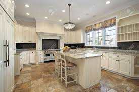 Light Wood Cabinets Kitchen Kitchen In Luxury Home With Light Wood Cabinetry Stock Photo