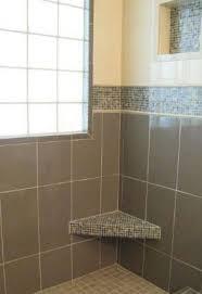 bathroom glass tile shower. mosaic tile shower: glass on seat and border bathroom shower