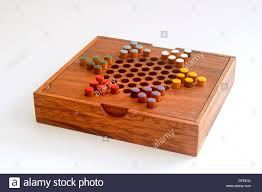 Wooden Board Game With Pegs Chinese checkers colour pegs on a wooden board A game of strategy 90